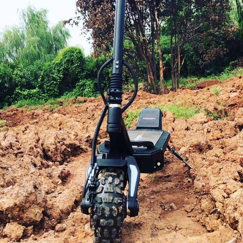 Dualtron Ultra 2 Knobby Tires Traversing Muddy Terrain